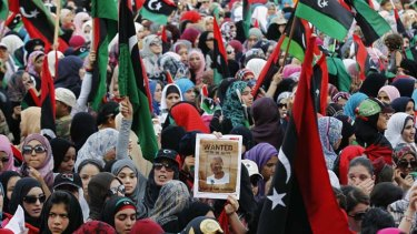 Ecstatic ... women and children gather in Martyrs Square, Tripoli, to celebrate their new-found freedom.