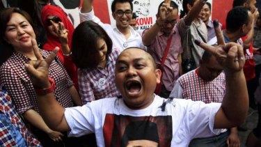 "Supporters of Jakarta governor Joko ""Jokowi"" Widodo celebrate in Makassar, South Sulawesi."