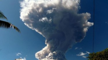 View of the Chaparrastique volcano spewing ashes and smoke.