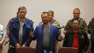 Separatist leader Alexander Borodai, centre, at the handover with Colonel Mohamed Sakri, right, of the Malaysian National Security Council.