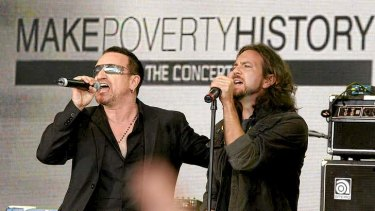 Bono from U2 and Eddie Vedder from Pearl Jam perform at a 'Make Poverty History' concert in Melbourne in 2006.