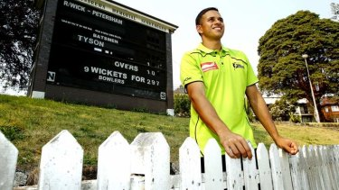 Usman Khawaja pictured after re-signing for the Sydney Thunder.