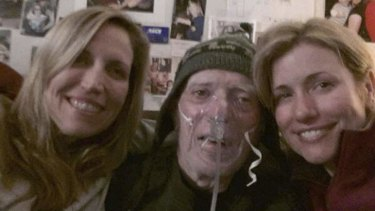 Laurie Kilmartin (left) with her father and sister.