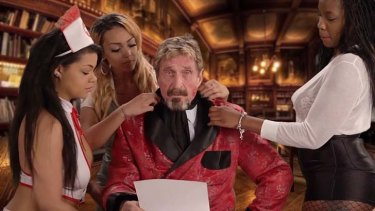John McAfee appears in a video where he rants about McAfee anti-virus software.