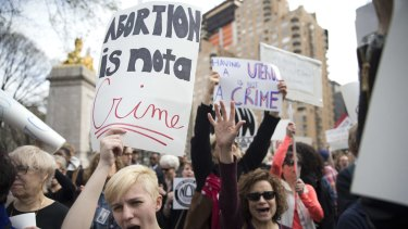 Demonstators at  rally in New York on Thursday protest against Republican presidential candidate Donald Trump's remarks about women and abortion.