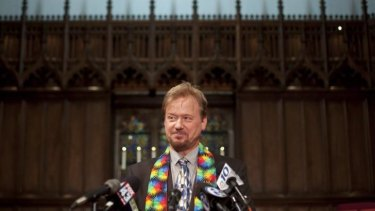 Frank Schaefer speaks to reporters after being reinstated as a pastor in Germantown, Pennsylvania, in June.