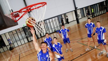 Brent Harvey goes through the hoops in the new gym.