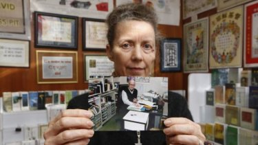 """There's no point [being] hysterical""' ... Karen Short, wife of Australian missionary John Short, poses with a photo of her husband inside the Christian Book Room in Hong Kong."