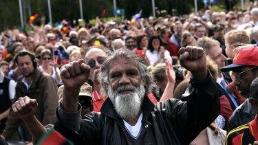 Reg Edwards raises his fists in triumph at Rudd's speech.