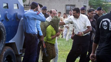 Heavily armed security officials rush Rimsha Masih, a Christian girl accused of blasphemy, to a military helicopter to fly her to a secret location.