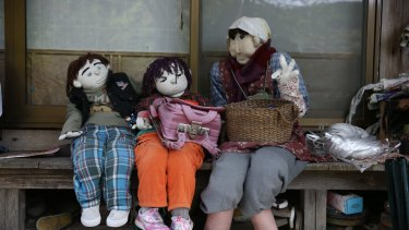 Hand-made dolls sit outside an abandoned house as others are placed around the village by local resident Tsukimi Ayano to replace the dwindling local population in Nagoro village, in Miyoshi, Japan.