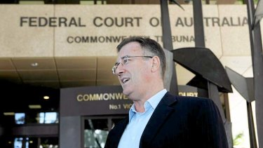Norm Carey leaving the Federal court in 2010 after ASIC reported they would return his passport.