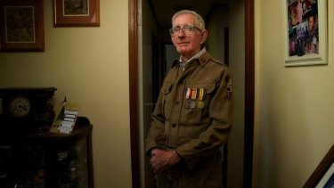 Tony Pickrell, 77, son of Maurice John Pickrell who fought in WWI, with his father's service uniform.