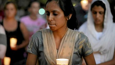 Mourners take part in a candlelight vigil for the victims of the shooting.