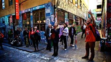 Tourists make their way through Hosier Lan