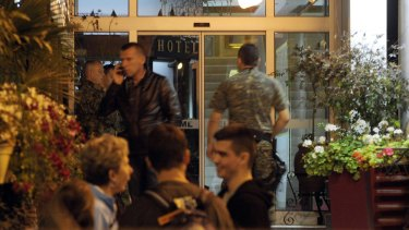 Isolated: Police guard the entrance of a quarantined hotel in Skopje, where the British man had stayed.