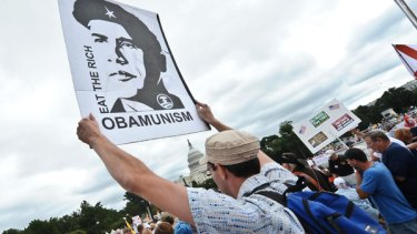 Protesters descended on Washington, some carrying placards lampooning President Barack Obama as a Che Guevara determined to take the US down a socialist path.