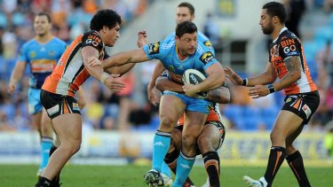 Taking on the line: Mark Minichiello tries to find a way through.