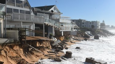 High tide begins to impact on damaged beachfront homes along Pittwater Road at Collaroy on the northern beaches of Sydney.