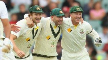 Shane Watson, Michael Clarke and Brad Haddin celebrate in Adelaide.
