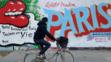 French street artists have been taking to city walls and billboards in Paris to paint notes of defiance.