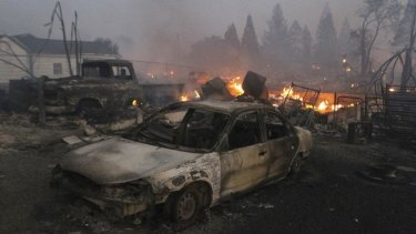 Vehicles and homes are destroyed in Weed, California where a wind-driven wildfire raced through the hillside neighbourhood and forced more than 1000 people to flee the small town near the Oregon border.