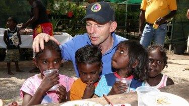 The Prime Minister meets children at the Gunyangara community.