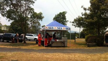 SES volunteers man a sausage sizzle for disappointed campers leaving North Stradbroke Island. Photo: Renae Henry/Ten News, via Twitter.