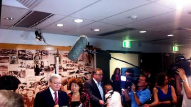 Scrum: Rudd  takes questions.