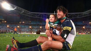 The moment: Johnathan Thurston with daughter Frankie after winning the 2015 NRL Grand Final.