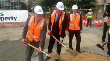 Tim Nicholls and Jeff Seeney turning the sod at 1 William Street.