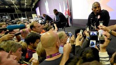 The media mobs US basketballer Kobe Bryant in London.
