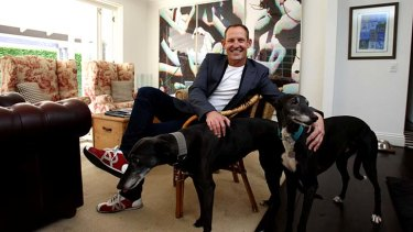 Many faces: Todd McKenney relaxes with his dogs.