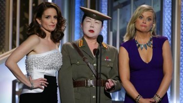 Tiny Fey (left), Margaret Cho and Amy Poehler make fun of North Korea at the Golden Globes.
