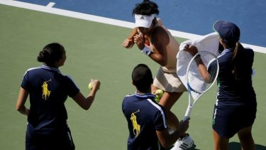 US Open ball boys and girls chase away bees from Kimiko Date-Krumm.