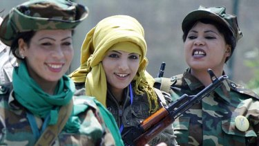 """Armed women supporters of the Gaddafi regime after their """"graduation ceremony"""" in Tripoli. The government says all mothers will be turned into """"killing machines""""."""