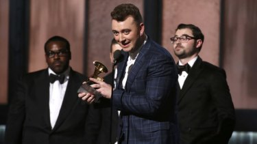 Sam Smith accepts the Grammy for record of the year.