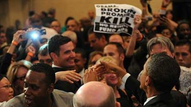 Secret Service hold back protesters who got into the room at the Roosevelt Hotel where President Barack Obama was speaking yesterday.