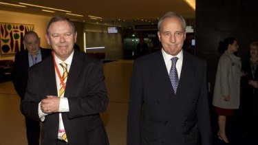 Paul Keating, right, arrives at the ACTU conference's black tie dinner.