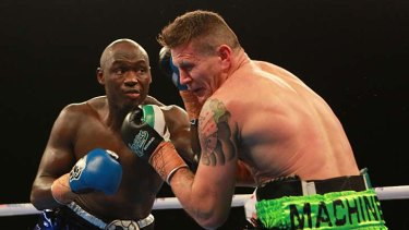 Danny Green and Antonio Tarver slug it out during their title fight in June.