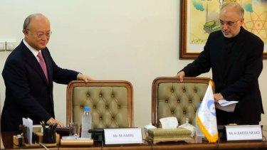 Pact: Iran's nuclear agency chief Ali Akbar Salehi (right) and International Atomic Energy Agency director-general Yukiya Amano at their meeting in Tehran.