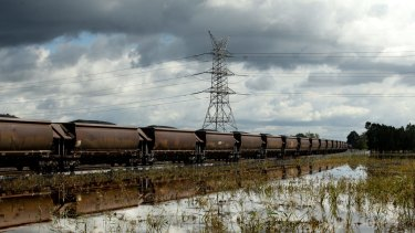 Rail haulers should renegotiate contracts with miners, Macquarie says.