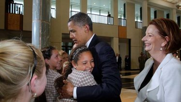 We still love him ... Barack Obama was embraced by Chelsea Gallagher on his last visit to Australia in 2011.