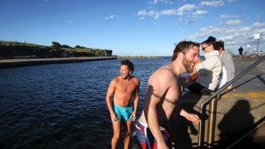 Weekend dip for UK visitors at Clovelly Beach.