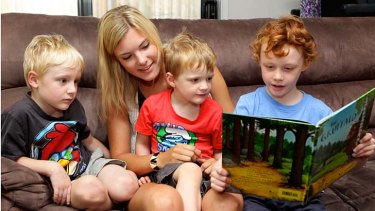 ''Like a big sister'' … German au pair Michelle Kaiser reads with the Rouwhorst boys - Alexander, 5, Samuel, 3, and Joshua, 8.