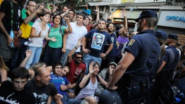 Police prevent 'indignants' from entering Puerta del Sol square in Madrid, Spain. The indignants came from across the country to protest high levels of unemployment.