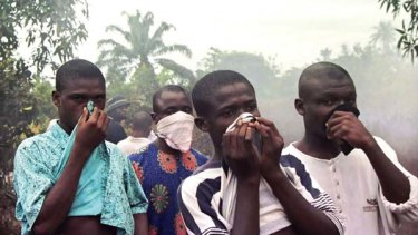 On the nose ... Ogoni villagers react to the stench from a Shell oil spill that was turning their drinking water black.