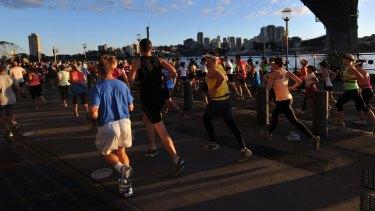 Westbound traffic: Half marathon runners head under the Harbour Bridge.