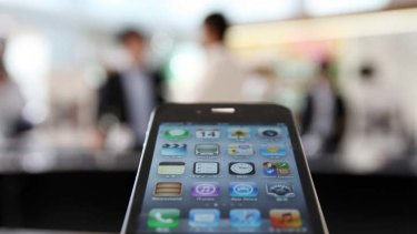 Sales of the blockbuster iPhone 4S were 'on fire' in the first three months of the year, says Apple.