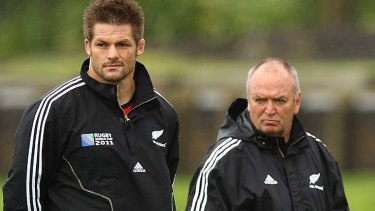 On the sidelines ... Richie McCaw and New Zealand coach Graham Henry watch on at training in Auckland today.